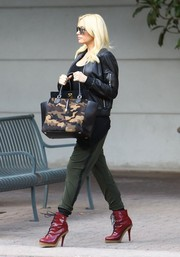 Gwen Stefani was spotted out in LA looking rocker-chic in a black leather jacket and red lace-up boots.