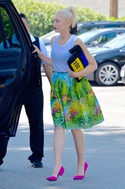 Gwen Stefani went all out with the colors, teaming her skirt with a blue and yellow fur clutch and hot-pink pumps.