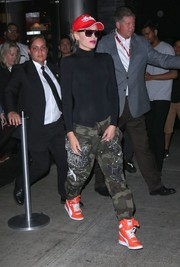 Gwen Stefani went for a sporty finish with a pair of orange hi-top sneakers by Puma.
