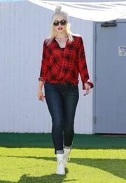 Gwen Stefani showed off her casual-chic maternity style in a red plaid faux-wrap top while visiting a friend in Studio City.