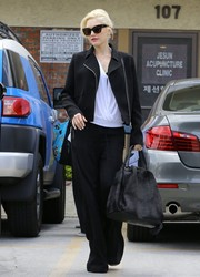 Gwen Stefani teamed slouchy black pants with a moto-chic jacket for a visit to an acupuncture studio.