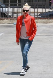 Gwen Stefani punched up her casual oufit with a bright orange moto jacket for a visit to her acupuncturist.