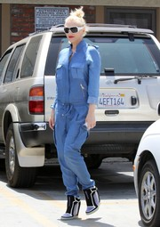Gwen Stefani rocked a pair of tricolor wedge boots with a denim jumpsuit during a visit to an acupuncture studio.