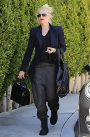 Gwen Stefani kept her look all dark colors when she accessorized her look with this black bag.