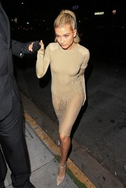 Hailey Baldwin finished off her outfit with nude ankle-tie pumps by Bionda Castana.