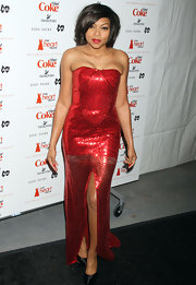 Taraji channels Jessica Rabbit in a beaded red evening gown for the Heart Truth's Red Dress collection NY show.