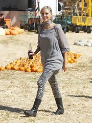 "Heidi Klum made a trip to the pumpkin patch in a pair of leopard print ""801"" Mid-Rise Super Skinny jeans."