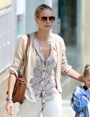 Heidi Klum took her daughter to ballet class carrying a tan leather satchel with gold hardware.