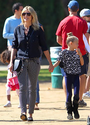 Heidi Klum got preppy with it in these vertically-striped skinny pants.