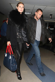 Heidi Klum looked fashionably fierce in a glitter- and fur-embellished coat.