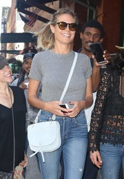 Heidi Klum donned a pair of round shades by Etnia Barcelona for some sun protection.