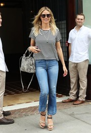 Heidi Klum capped off her casual attire with a pair of embellished platform sandals.