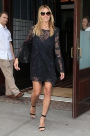 Heidi Klum went for easy elegance in a black lace mini dress for a day out in New York City.