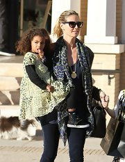 Heidi Klum layered a leopard print scarf over her jacket.
