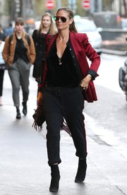Heidi Klum pulled her outfit together with a pair of black suede ankle boots by Gianvito Rossi.