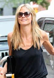 Heidi Klum went retro cool with a pair of cateye sunnies.