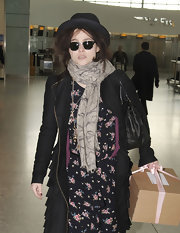 Helena Bonham Carter wore this patterned scarf with her eclectic ensemble for her flight out of London.