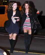 Ashley Tisdale carried a black leather Giant city bag to the 'Hellcats' wrap party.