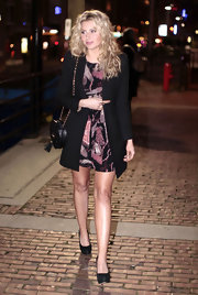 Alyson Michalka paied her party attire with a round quilted black leather bag with a gold chain strap.