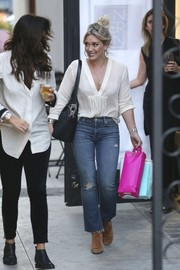 Hilary Duff hit the salon wearing a stylish white V-neck blouse.