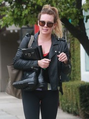 Hilary Duff was spotted out in her workout gear, which she toughened up with a black leather jacket by IRO.