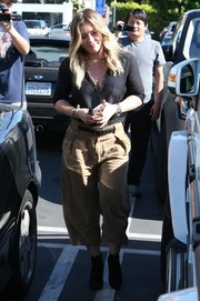 Hilary Duff went shopping at Fred Segal sporting baggy beige capris and a black button-down.