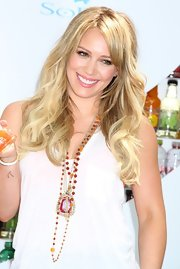 Hilary Duff styled her blond tresses in long curls for the SoBe promotional event.