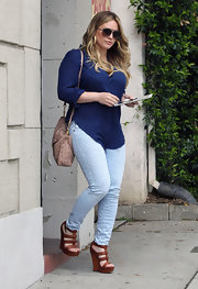 Hilary Duff steps out of a salon in Beverly Hills wearing a pair of rich brown leather wedges.