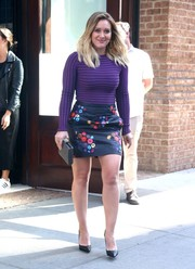 Hilary Duff headed out in New York City looking sexy in a fitted purple top.