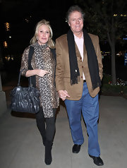 Kathy Hilton kept warm in black suede mid-calf boots. The wore the shoes over black leggings.