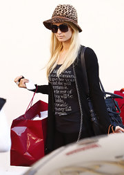 Paris wears a fierce leopard print hat while out shopping in West Hollywood. The starlet also donned a tee with a romantic paragraph under a long black cardigan.