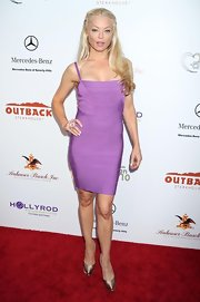 Charlotte Ross paired her bandage dress with satin Casadei pumps.