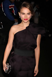 Natalie Portman added glamour to her red carpt look with a Christian Dior clutch. The glimmering accessory added the perfect dose of sparkle to an all black look.