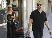 Coco was spotted out shopping on Rodeo Drive carrying a stylish black patent leather hobo bag.