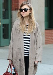 Imogen Poots accessorized with a pair of angular shades for a day out in New York City.