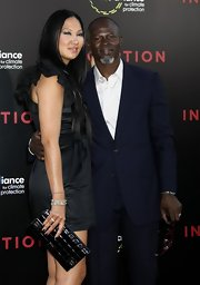 Kimora Lee showed off her stunning box clutch while hitting the 'Inception' premiere.