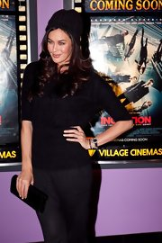 A black velvet clutch added a touch of elegance to Megan Gale's casual ensemble at the Melbourne premiere of 'Inception.'