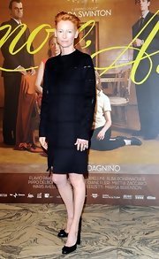 Tilda Swinton wore a geometric black wool coat to the premier of her movie 'lo Sono L'amore' in Italy