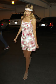 Isabel was spotted in a sweet, polka dotted romper with a lace headband and flat, lace-up sandals.