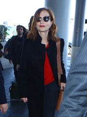 Isabelle Huppert kept it classic with these cateye sunnies while catching a flight out of LAX.