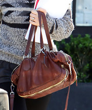 Isla Fisher finished off her black and gray fall look with a burgundy Prada bag.