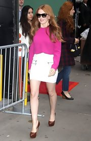 Isla chose this hot pink blouse to pair with a white mini for her bright and cheerful look on 'Good Morning America.'