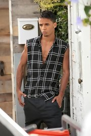 Aston wears his hair in a short, cropped, side-part.