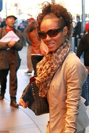 Jada Pinkett Smith paired this animal print scarf with her eclectic ensemble while out in NYC.