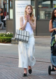Jaime King sealed off her shopping ensemble with a pair of black patent loafers.
