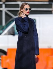 Jaime King was spotted out in New York City wearing a pair of ultra-modern shades by Karen Walker.