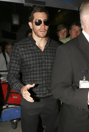 Jake Gyllenhaal looked classic in a plaid button down shirt and gold aviator sunglasses.