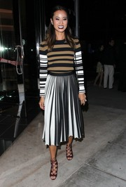 Jamie Chung was spotted at Sephora looking cozy and stylish in a tricolor striped sweater by Givenchy.