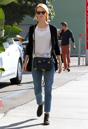 January Jones transformed her sleek cross-body bag into a gigantic piece of jewelry by wearing it draped around her neck.