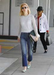 January Jones accessorized her outfit with a tricolor leather shoulder bag by Milli Millu.